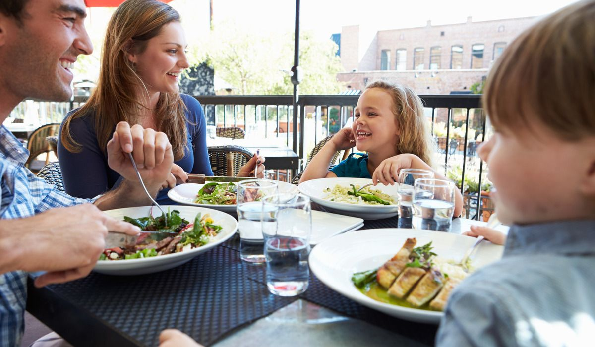 Photodune 11161075 family enjoying meal at outdoor restaurant m
